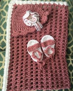 Newborn girl's blankie, hat and sandals